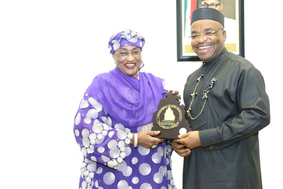 Akwa Ibom State Governor, Mr. Udom Emmanuel presenting a momento to Minister of Women Affairs, Senat