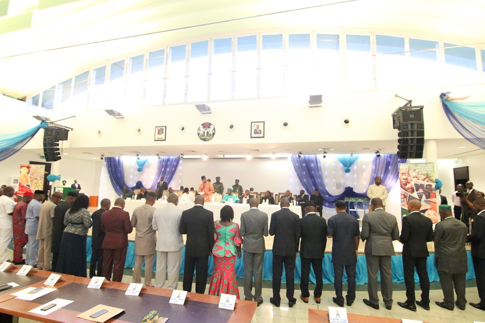 Governor Emmanuel administering oath of  office to the 27 men and 3 women Chairmen of 30 Local Gover